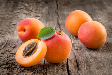 Apricot. Organic fruits with leaf on wooden background
