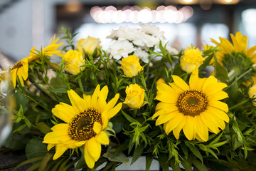floral arrangement of small yellow sunflowers