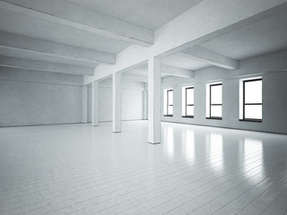 Loft space. Grey concrete walls. Wooden floor.