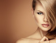 Salon hairstyle model. Young woman with magnificent hair