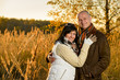 Couple embracing in autumn countryside sunset