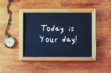 top view of blackboard with the phrase today is your day written