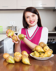 Happy brunnette  girl with pears