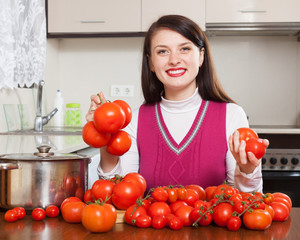 Happy woman  with fresh red tomatoes