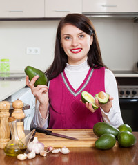 woman cooking with avocado in home