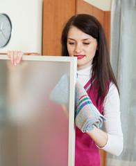 brunette woman dusting glass