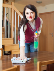 brunette girl cleaning table
