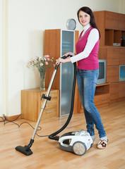 brunette woman vacuuming  living room