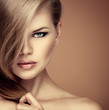 Portrait of fashion girl with professional makeup and hairstyle