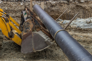 District heating pipe, ready for installation near trench