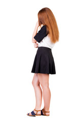 Back view of  pointing woman. beautiful redhaired  girl . girl s