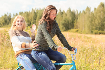 Bicycle ride of two attractive girls