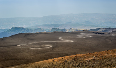 Serpentine road to the top of Mount Etna volcano