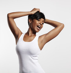 happy posing black woman in a white blanc top