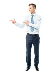 Young businessman pointing copyspace