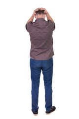 Back view of angry young man in jeans and shirt.