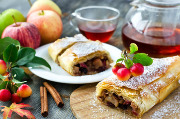 Baked strudel with apples on a plate