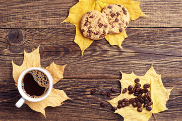Coffee, cookies and autumn leaves