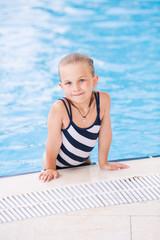 Cute little girl in swimming pool