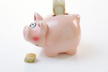 Coin Falling into a Piggy Bank
