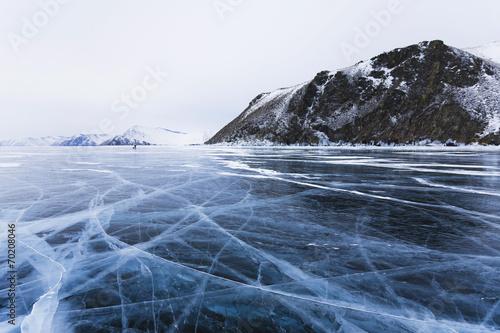 Leinwandbild Motiv Ice cracks on Baikal surface