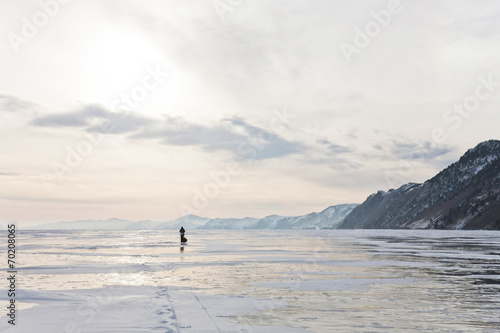 Lonely traveler on Baikal surface - 70208065