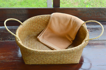 bath towel in wicker basket