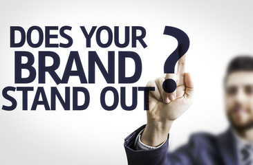 Business man pointing: Does your Brand Stand Out?