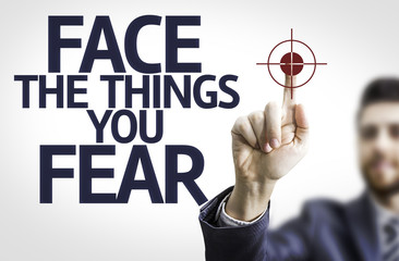 Business man pointing the text: Face the Things you Fear