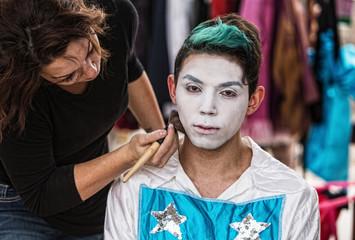 Woman Brushing Makeup on Clown