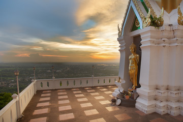 Stand buddha statue during sunset
