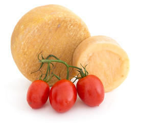Rustic cheeses with tomatoes over white background.