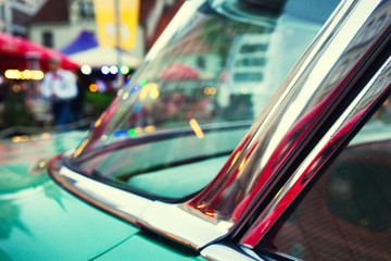 Evening city lights in glasses vintage car