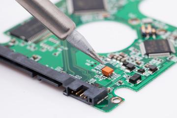worker repair green harddisk pcb