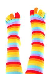 Female feet in colorful toe socks