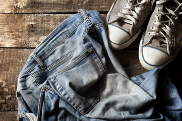 Dirty old jeans and sneakers
