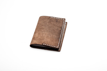 brown leather wallet on white, close up