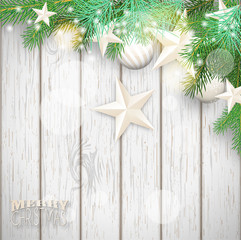 Christmas background with green branches and yellow ornaments