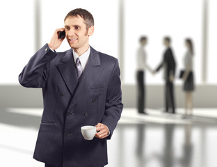 Successful businessman in business center calling by phone