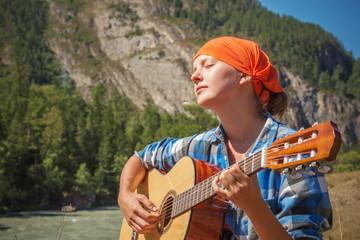 tourist girl playing a guitar