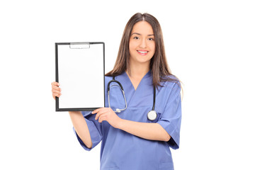 Female doctor holding a blank paper on clipboard