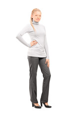 Full length portrait of a woman in casual clothes posing