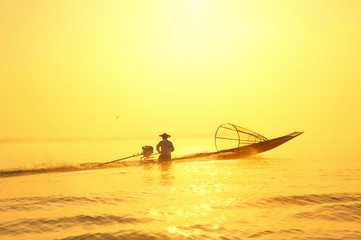 Traveling to Myanmar, outdoor photography of fisherman on tradit
