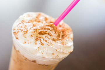 Ice And Whip Cream Frappe Coffee With Chocolate Topping Close Up