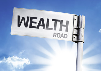 Wealth written on the road sign