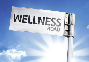 Wellness written on the road sign