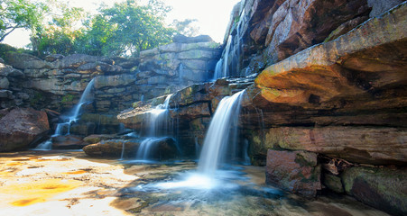Nature landscape background of waterfall and rocks
