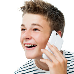 Handsome teen talking on smart phone.