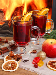 Mulled wine - two glasses on the background of a burning firepla