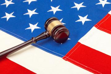 Wooden judge gavel over US flag